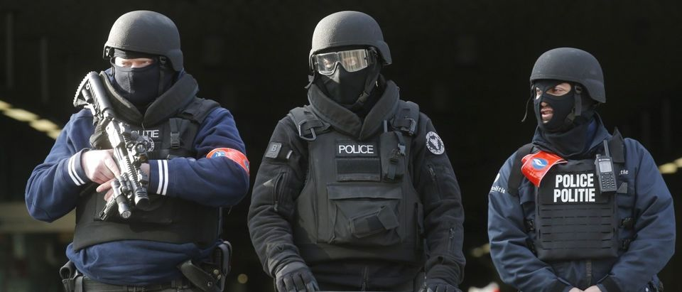 Police stand guard at Midi train station following bomb attacks in Brussels, Belgium