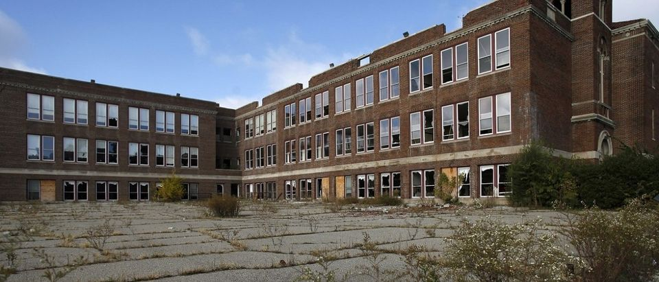 A crumbling, abandoned Colin Powell Elementary School in Detroit. [REUTERS/Joshua Lott]