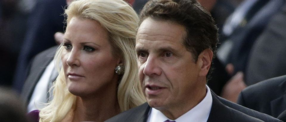 New York Governor Andrew Cuomo and girlfriend Sandra Lee look on as Pope Francis tours Our Lady Queen of Angels School in East Harlem in New York