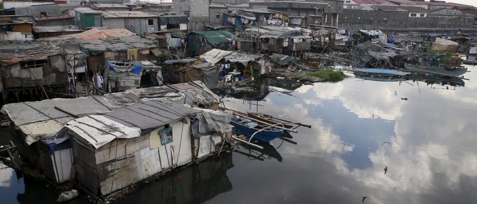 Shanties are built by residents over a polluted river in Navotas city, north of Manila