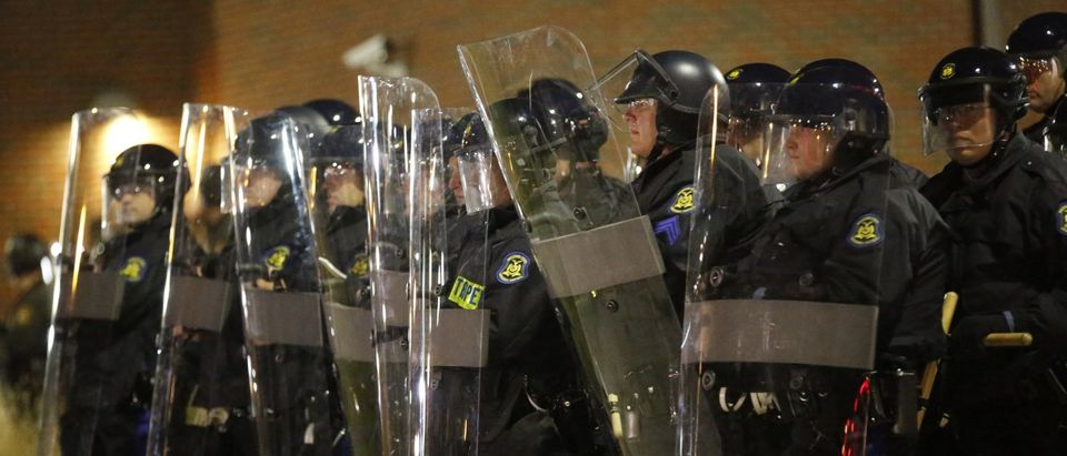 Missouri State Troopers in riot gear stand in formation outside the Ferguson Police Department in Ferguson, Missouri, November 24, 2014. A St. Louis County grand jury chose not to indict Ferguson policeman Darren Wilson in the Aug. 9 shooting death of Michael Brown, 18, St. Louis County Prosecutor Bob McCulloch said. REUTERS/Jim Young