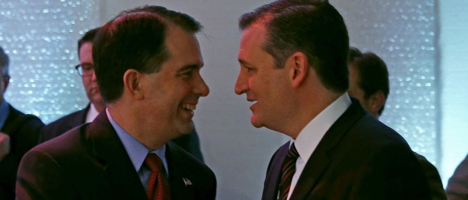 Governor of Wisconsin Scott Walker shakes hands with Senator of Texas Ted Cruz at the Iowa Faith and Freedom Coalition's forum in Waukee, Iowa