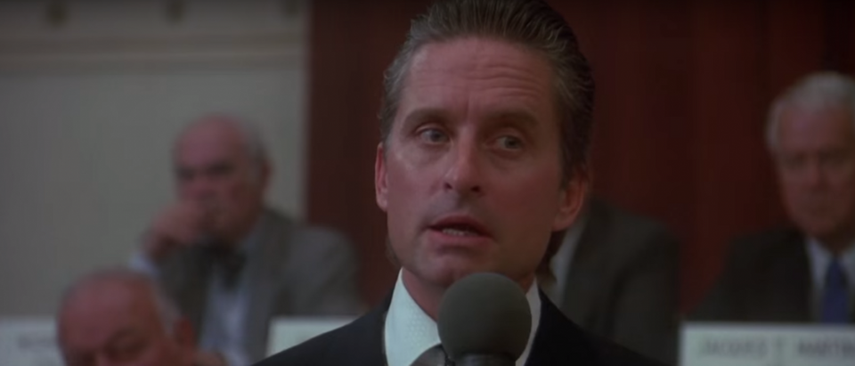 "Gordon Gekko giving ""Greed is good"" speech in Wall Street - YouTube screenshot"