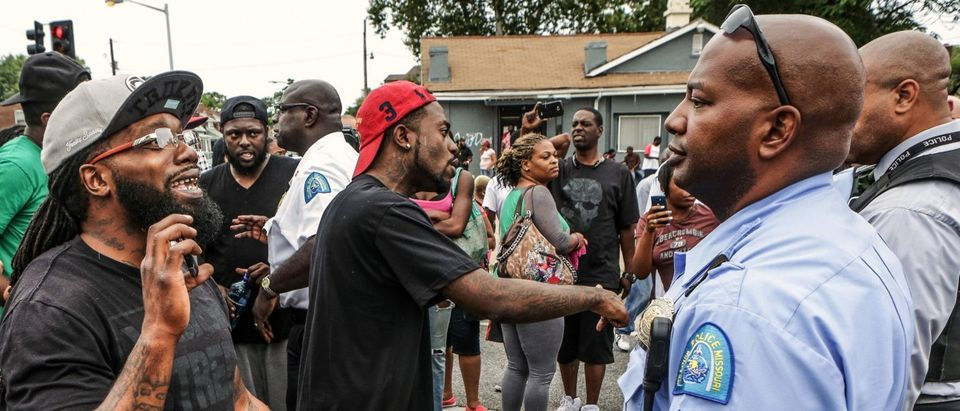 Area residents asking talk to police after a shooting incident in St. Louis