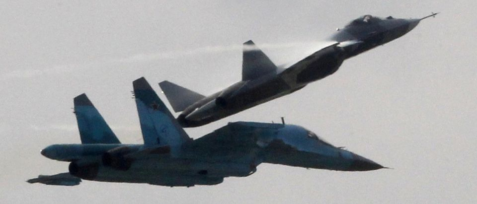 A T-50 and a Su-32 fighters perform during the MAKS International Aviation and Space Salon in Zhukovsky, outside Moscow
