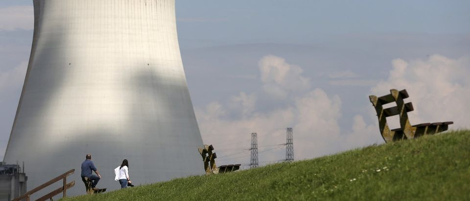 People look at the cooling towers of Doel's nuclear plant in northern Belgium