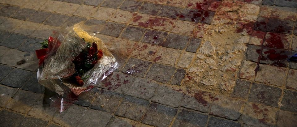A bouquet stained with blood is seen where, according to Israeli police spokesperson, at least 10 Israelis were stabbed, in the popular Jaffa port area of Tel Aviv, Israel