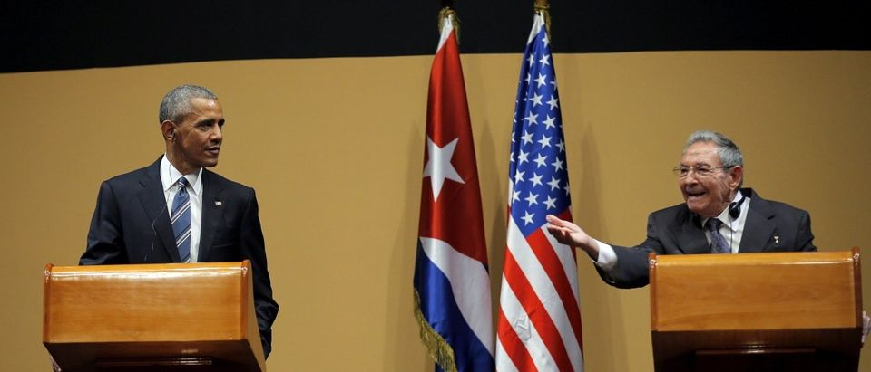 Cuban President Raul Castro answers a question during a news conference with U.S. President Barack Obama as part of Obama's three-day visit to Cuba, in Havana