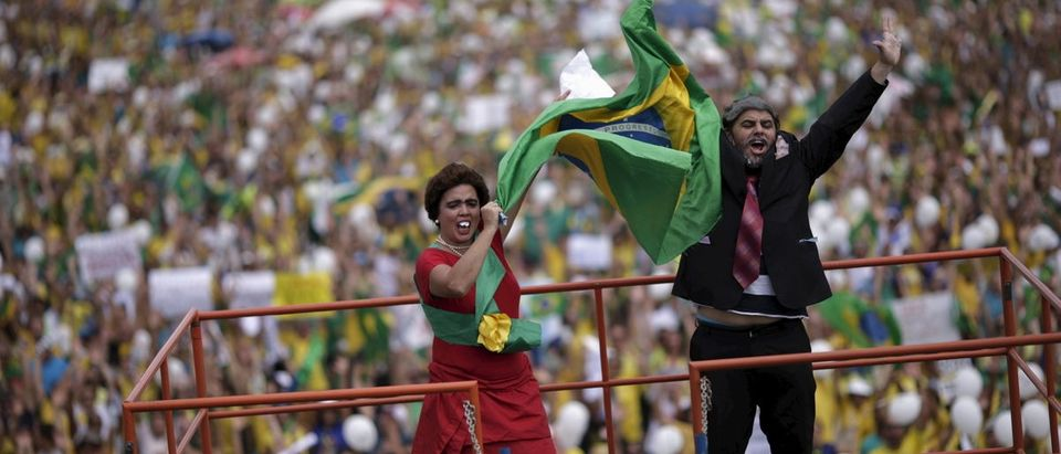 Demonstrators depicting Brazil's former president Lula da Silva and Brazil's President Rousseff attend a protest against Rousseff, part of nationwide protests calling for her impeachment, in Brasilia