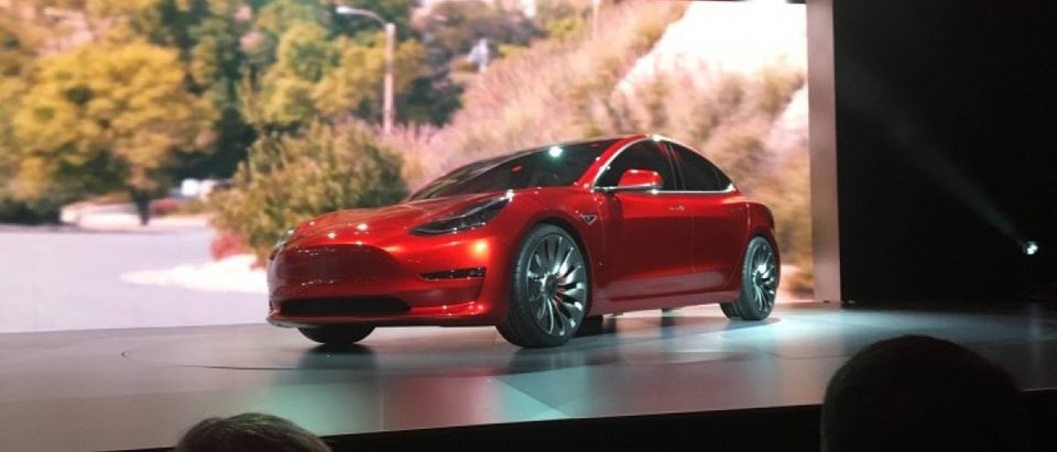 A Tesla Model 3 sedan, its first car aimed at the mass market, is displayed during its launch in Hawthorne, California, March 31, 2016. Picture taken March 31, 2016. REUTERS/Joe White