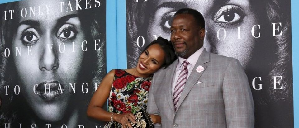 "Cast members Washington and Pierce pose at the premiere for the television movie ""Confirmation"" in Los Angeles"