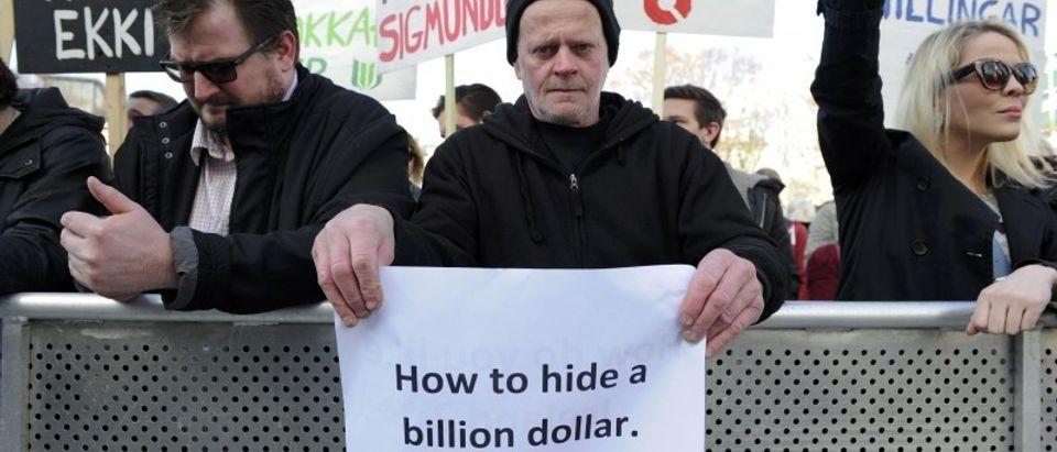 People demonstrate against Iceland's Prime Minister Gunnlaugsson in Reykjavik