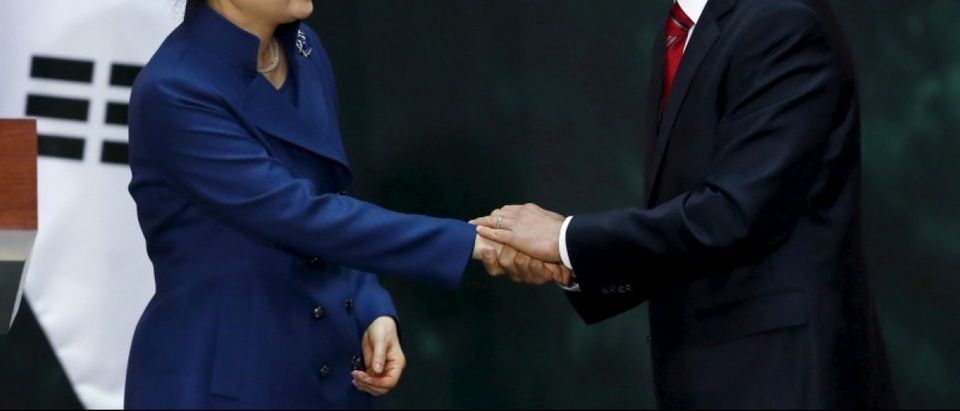 Mexico's President Enrique Pena Nieto shakes hands with South Korean President Park Geun-Hye during a welcome ceremony at the National Palace in Mexico City
