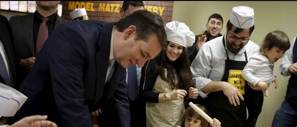 Republican presidential candidate Ted Cruz and children make the traditional Jewish bread, matzah at a campaign event in the Brooklyn borough of New York