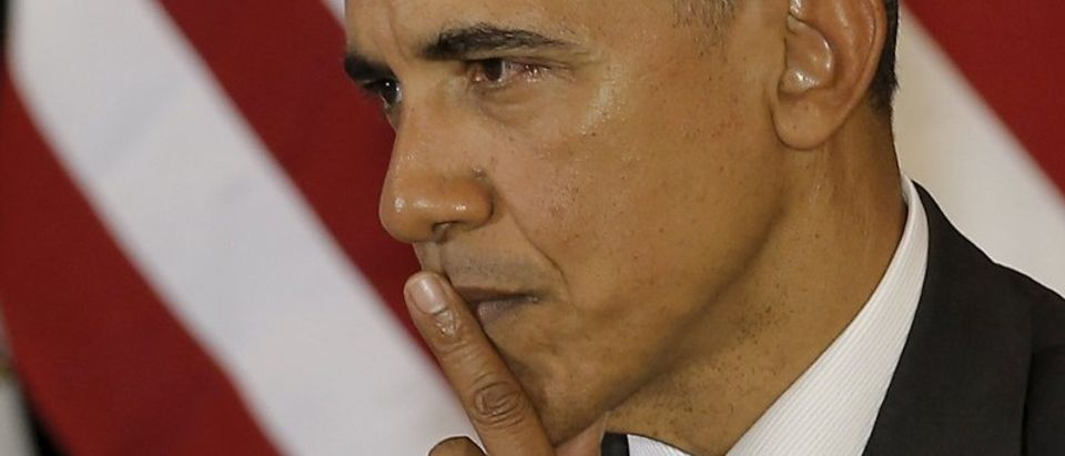 President Barack Obama listens to remarks at the University of Chicago Law School in Chicago
