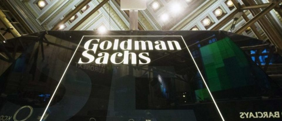 Goldman Sachs sign is seen above floor of the New York Stock Exchange shortly after the opening bell in New York