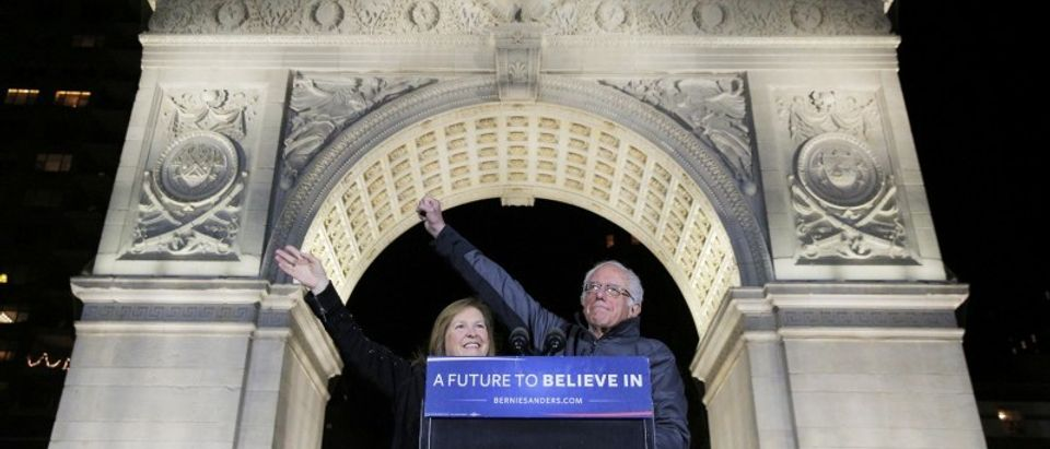U.S. Democratic presidential candidate Bernie Sanders and his wife Jane acknowledge supporters at a campaign rally in Washington Square Park in the Greenwich Village neighborhood of New York City