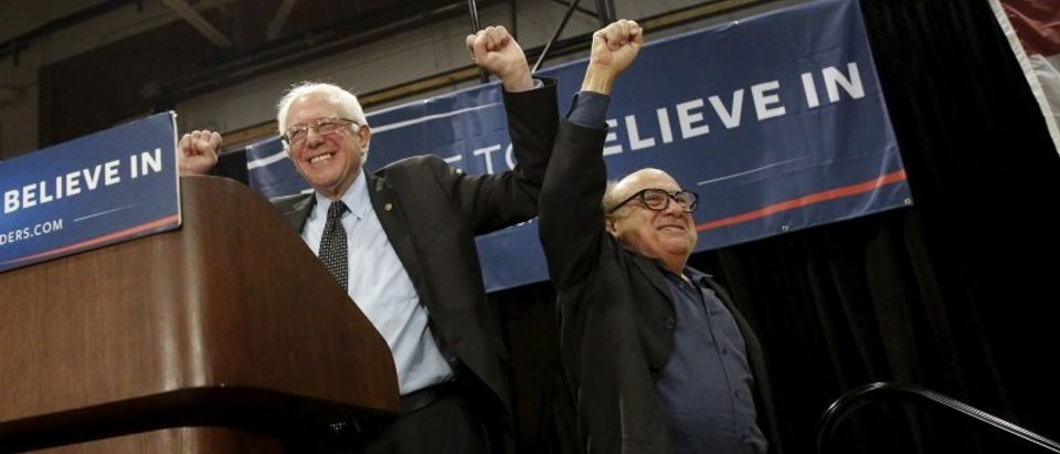 U.S. Democratic presidential candidate Bernie Sanders and actor Danny DeVito gesture during a rally at Affton High School in St. Louis