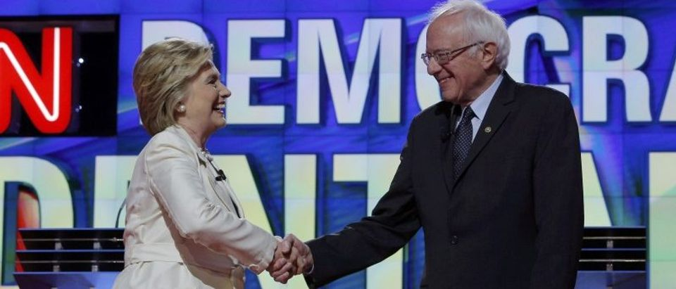 Democratic U.S. presidential candidate Clinton shakes hands with Senator Sanders at the start of their debate in New York