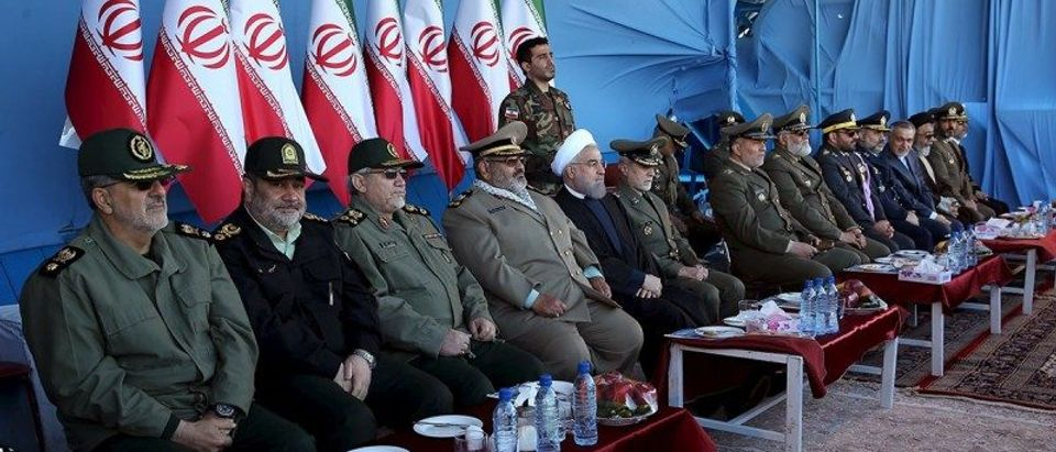 Iranian President Hassan Rouhani (5th L) attends a military parade marking National Army Day in Tehran