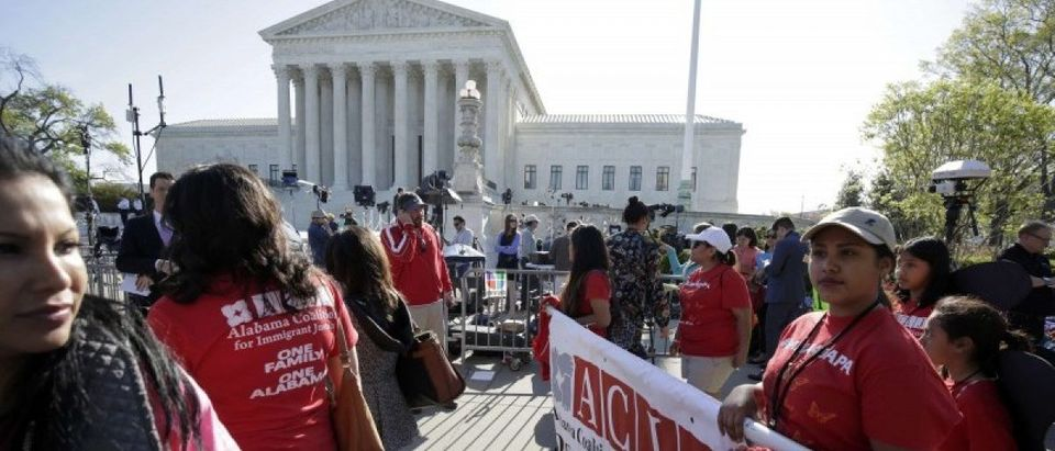 Immigration activists rally outside the U.S. Supreme Court in Washington