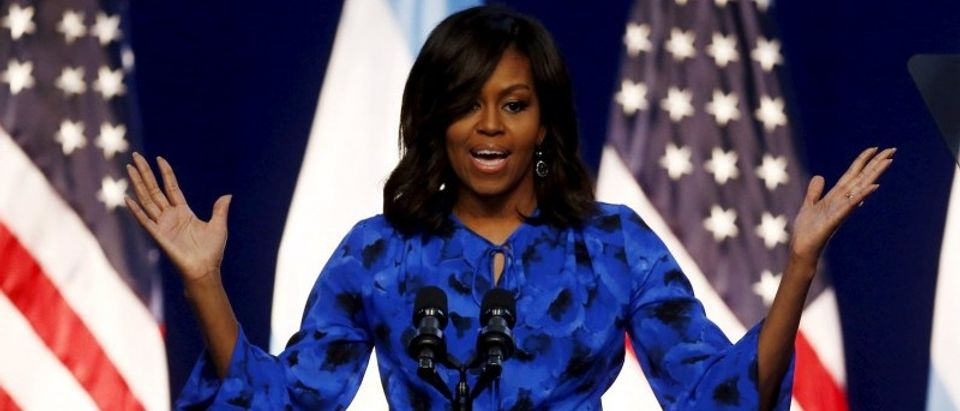 First lady Michelle Obama speaks before a group of schoolgirls in Buenos Aires, March 23, 2016. REUTERS/Marcos Brindicci
