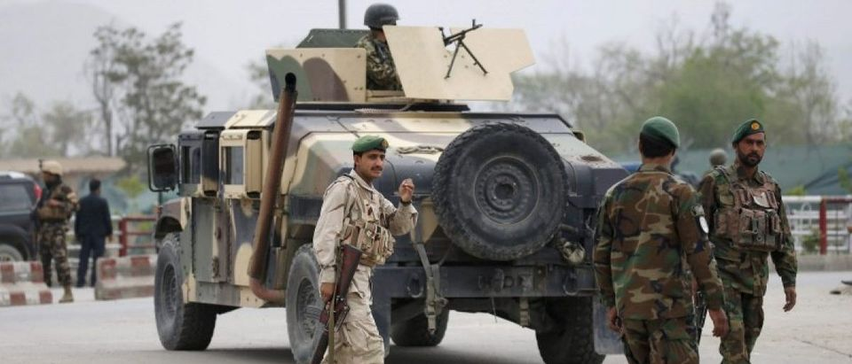 Afghan National Army (ANA) arrive at the site of a suicide car bomb attack in Kabul, Afghanistan
