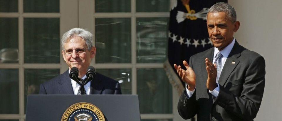 File photo of Judge Merrick Garland speaking at the podium in front of U.S. President Barack Obama in Washington