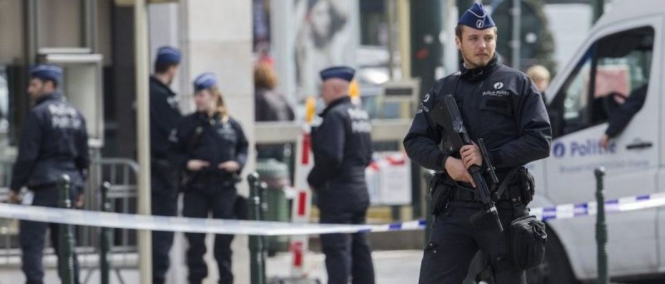 Belgian police officer secures the zone outside a courthouse while Brussels attacks suspects Mohamed Abrini and Osama Krayem appear before a judge, in Brussels