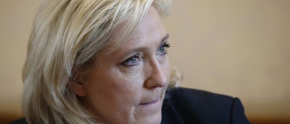 France's far-right National Front political party leader Marine Le Pen attends a news conference at the National Assembly in Paris