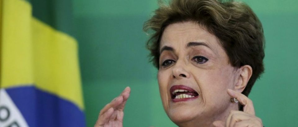 Brazil's President Dilma Rousseff gestures during a news conference for foreign journalists at Planalto Palace in Brasilia