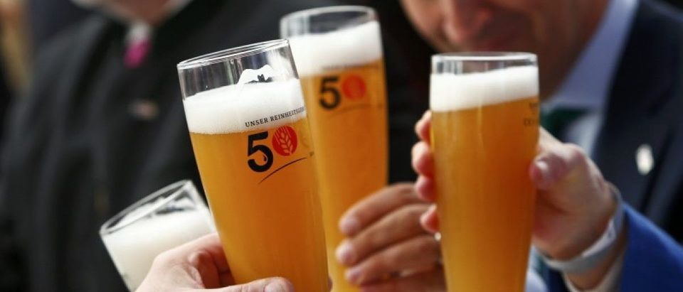 People hold beer glasses as they attend 500th anniversary ceremony of the German Beer Purity Law in Ingolstadt