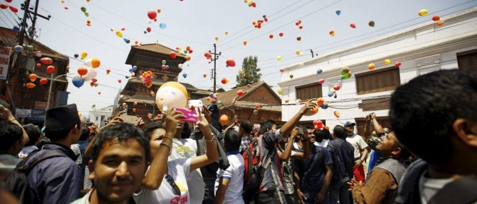 People release balloons during an event organized to commemorate the victims of last year's earthquakes in Kathmandu