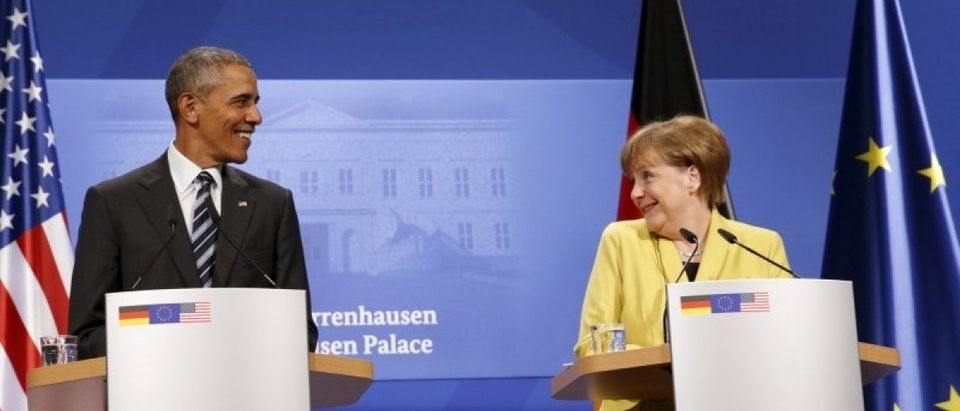 U.S. President Barack Obama and German Chancellor Angela Merkel smile at one another during a news conference at Schloss Herrenhausen in Hanover