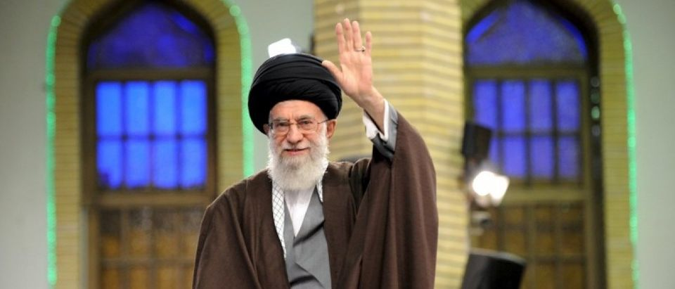 Iran's Supreme Leader Ayatollah Ali Khamenei waves as he arrives to address workers in Tehran