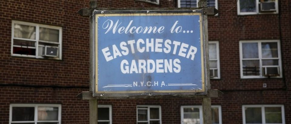A sign for the Eastchester Gardens NYCHA housing complex stands in the Bronx