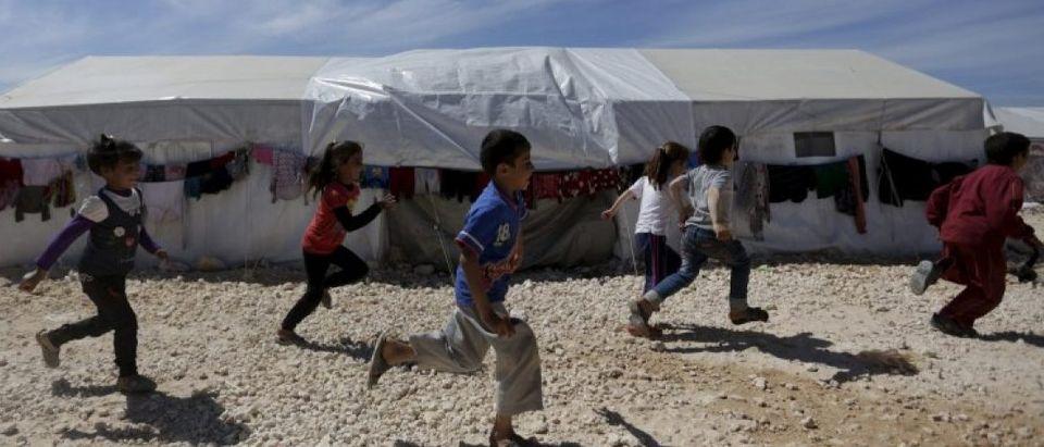 Internally displaced children run inside a refugee camp in Dana town after fleeing Palmyra, in northern Idlib province