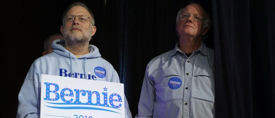 Ben Cohen and Jerry Greenfield, the founders of Ben & Jerry's ice cream, listen to U.S. Democratic presidential candidate Bernie Sanders speak at a campaign event in Exeter