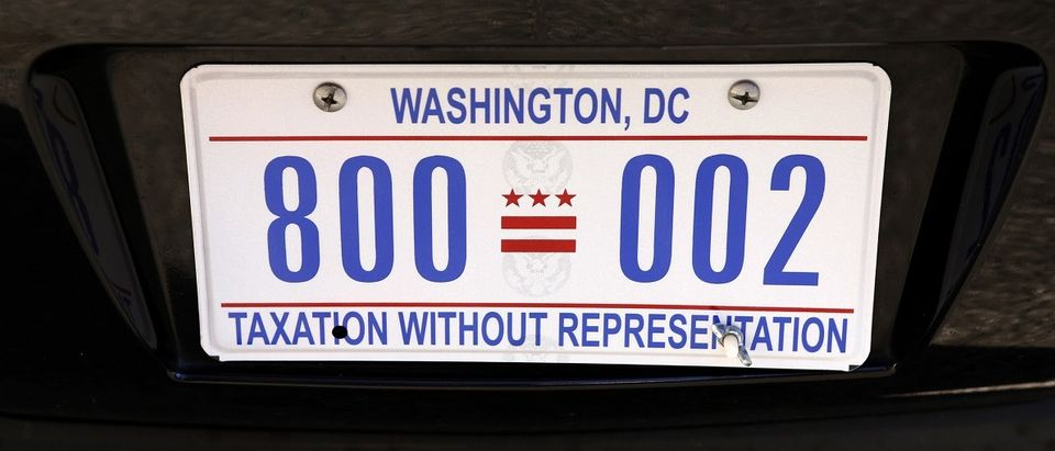 "The motorcade vehicle of U.S. President Barack Obama bears the license plate ""Taxation Without Representation"" in Washington"