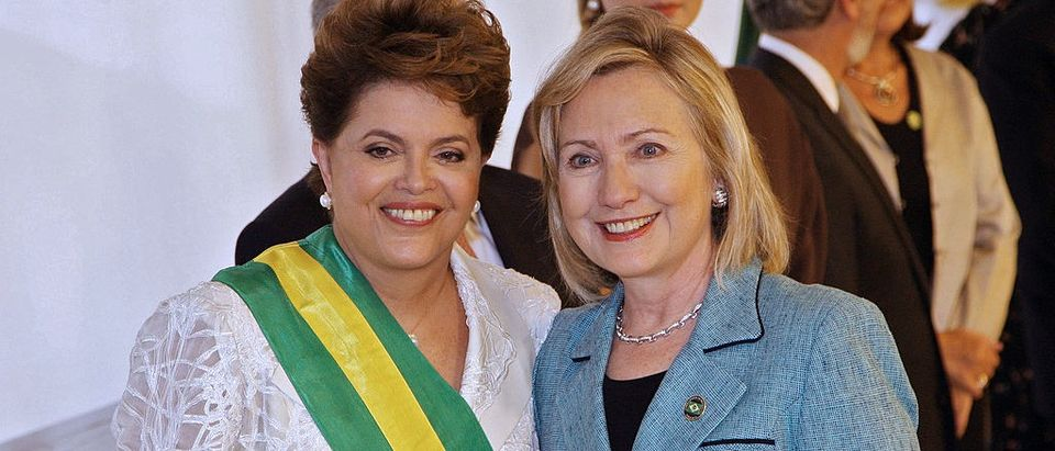 Brazilian President Dilma Rousseff poses next to Secretary of State Hillary Clinton during her inauguration at Planalto Palace in Brasilia, on January 1, 2011