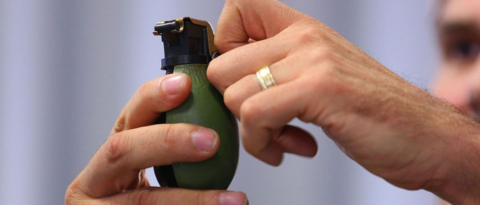 German policeman Andreas Stenger holding a hand grenade [Thomas Niedermueller/Getty Images]