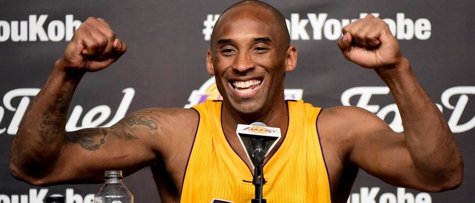 Kobe Bryant of the Los Angeles Lakers smiles during the post game news conference after scoring 60 points in the final game of his NBA career at Staples Center on April 13, 2016 in Los Angeles