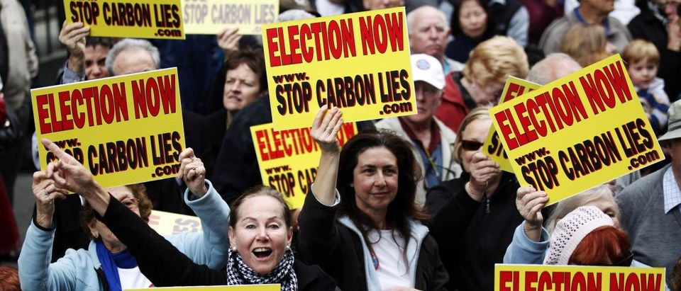 A woman shouts slogans against a carbon tax during a protest in central Sydney