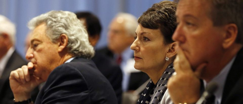 CEO of Duke Energy Lynn Good (C) listens to U.S. President Barack Obama answer questions from business leaders while at the quarterly meeting of the Business Roundtable in Washington, December 3, 2014. REUTERS/Larry Downing