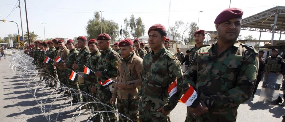 Iraqi security forces gather in the streets during a sit-in for supporters of prominent Iraqi Shi'ite cleric Moqtada al-Sadr, near the gates of Baghdad