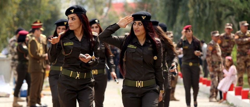 Female Kurdish Peshmerga attend their graduation ceremony at a police academy in Zakho