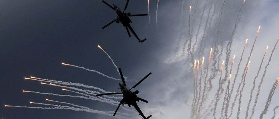 """A Mi-28N helicopter display team flies in formation during a performance before its hard touchdown at the """"Aviadarts"""" military aviation competition near Ryazan"""