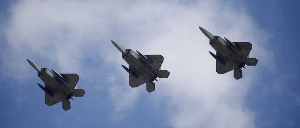 U.S. F-22 stealth fighter jets fly over Osan Air Base in Pyeongtaek