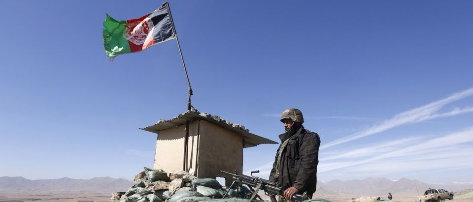 An ANA soldier keeps watch at a checkpost in Logar province, Afghanistan