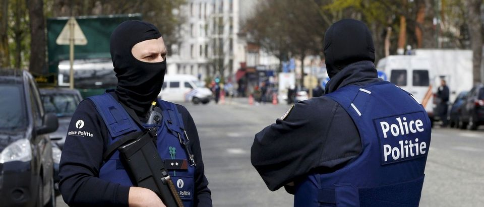 Belgium police officers secure the access during a police operation in Etterbeek